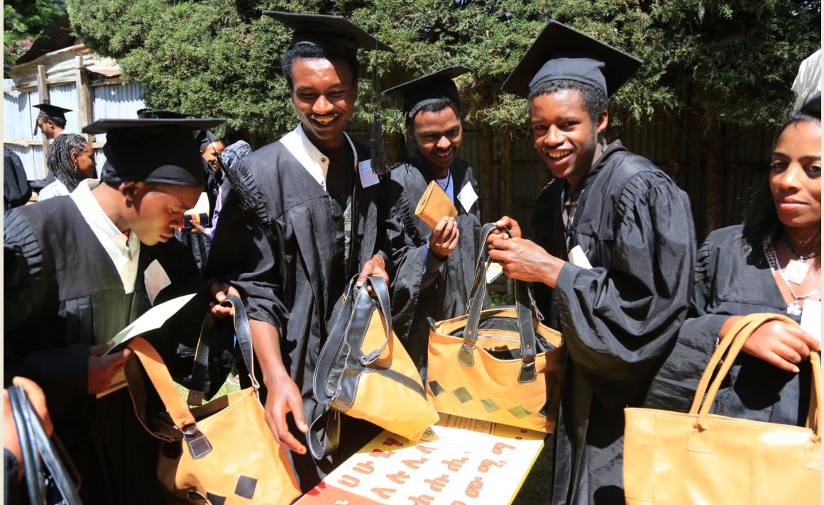 Youth graduates on  leather work